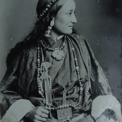 A Tibetan lady wearing a traditional  dress.