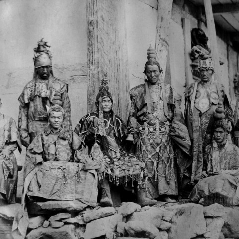 A group of monks in their elaborate costumes